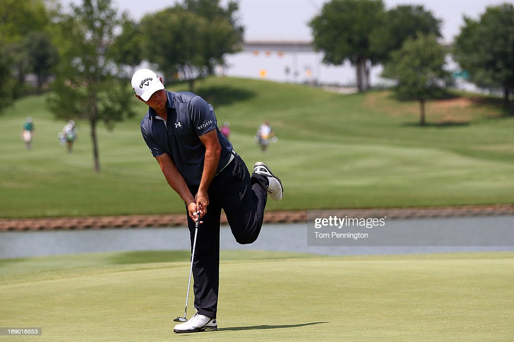 Gary Woodland reacts to a missed putt during the third round of the 2013 HP Byron Nelson Championship at the TPC Four Seasons Resort on May 18, 2013 in Irving, Texas.