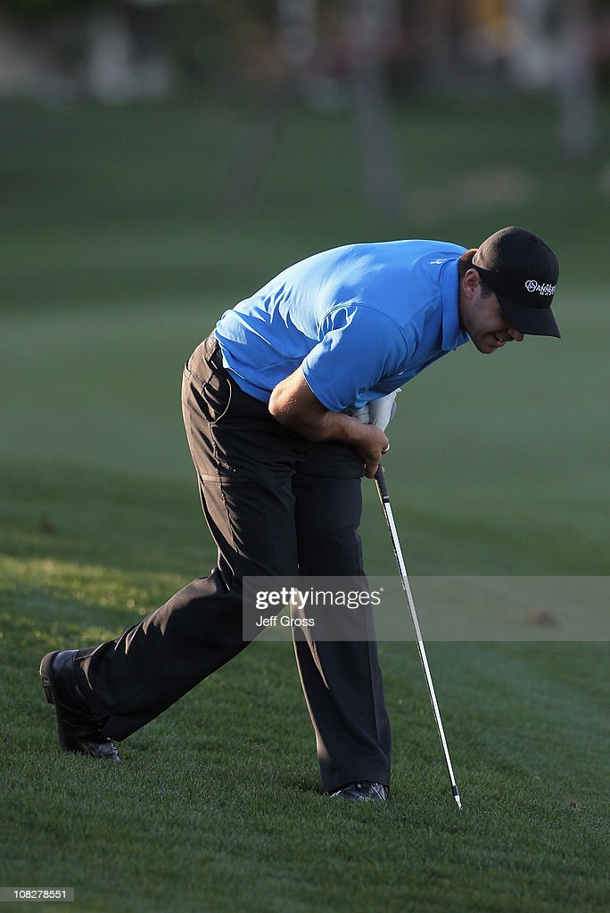 Gary Woodland reacts to his second shot on the 18th hole during the final round of the Bob Hope Classic at the Palmer Private course at PGA West on January 23, 2011 in La Quinta, California.