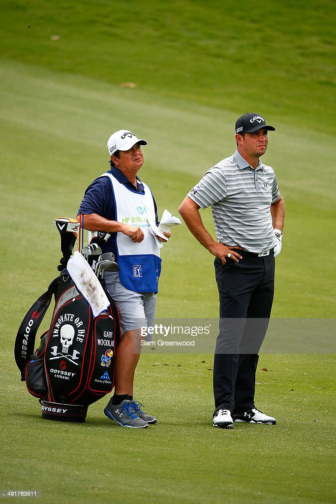 Gary Woodland waits with his caddie Tony Navarro on the sixth hole during the third round of the HP Byron Nelson Championship at the TPC Four Seasons on May 17, 2014 in Irving, Texas.