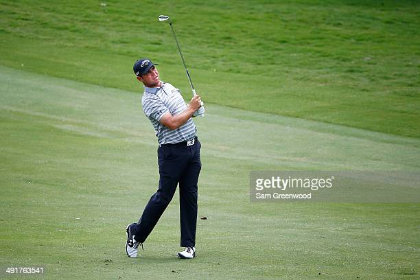 Gary Woodland watches his fairway shot on the sixth hole during the third round of the HP Byron Nelson Championship at the TPC Four Seasons on May 17...