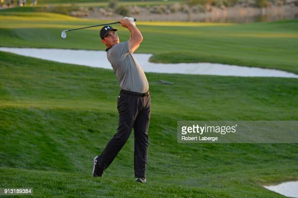 Gary Woodland watches his second shot on the 17th hole during the first round of the Waste Management Phoenix Open at TPC Scottsdale on February 1...