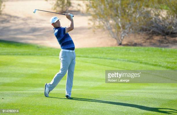 Gary Woodland watches his second shot on the first hole during the final round of the Waste Management Phoenix Open at TPC Scottsdale on February 4...