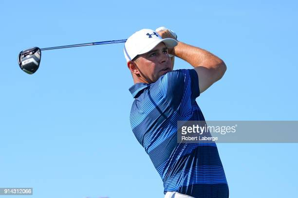 Gary Woodland watches his tee shot on the 15th hole during a playoff for the Waste Management Phoenix Open at TPC Scottsdale on February 4 2018 in...