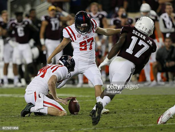 Gary Wunderlich of the Mississippi Rebels kicks a 39 yard field goal as Alex Sezer of the Texas AM Aggies misses on the block to take the lead 2928...
