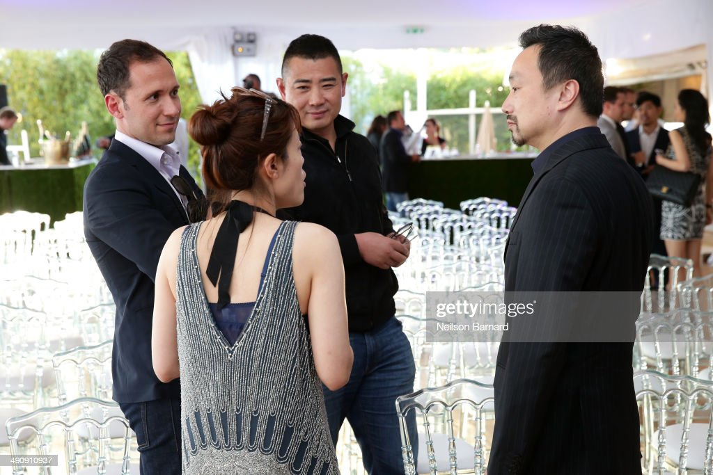 Gary Zhang (R) attends the 2014 Cannes Aquamen KONG Event At Mandala Beach / Cheri Cheri during the 67th Annual Cannes Film Festival at Mandala Beach on May 15, 2014 in Cannes, France.