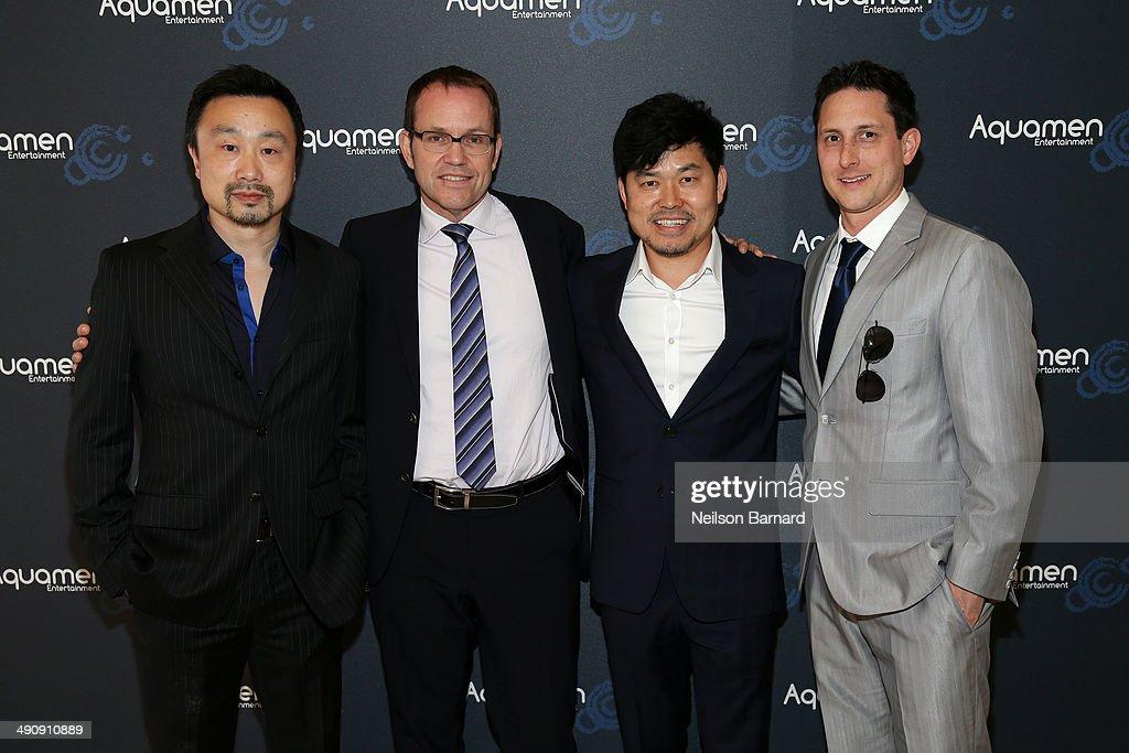 Gary Zhang, Brian O'Shea, JJ Kim and Nat McCormick attend the 2014 Cannes Aquamen KONG Event At Mandala Beach / Cheri Cheri during the 67th Annual Cannes Film Festival at Mandala Beach on May 15, 2014 in Cannes, France.