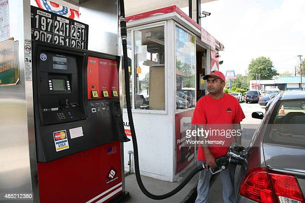 Gas attendant at a 19 Petroleum gas station pumps gas on August 25, 2015 in Woodbridge, New Jersey. Some places in New Jersey are seeing prices under...