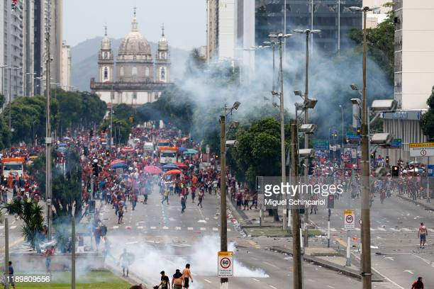 Gas bombs are thrown at fans of Flamengo by the police during the celebrations the day after Flamengo won the Copa CONMEBOL Libertadores on November...