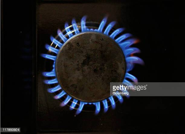 Gas burns on a domestic oven's hob in Hornchurch UK on Friday July 1 2011 United Kingdom will become the world's thirdlargest importer of liquefied...