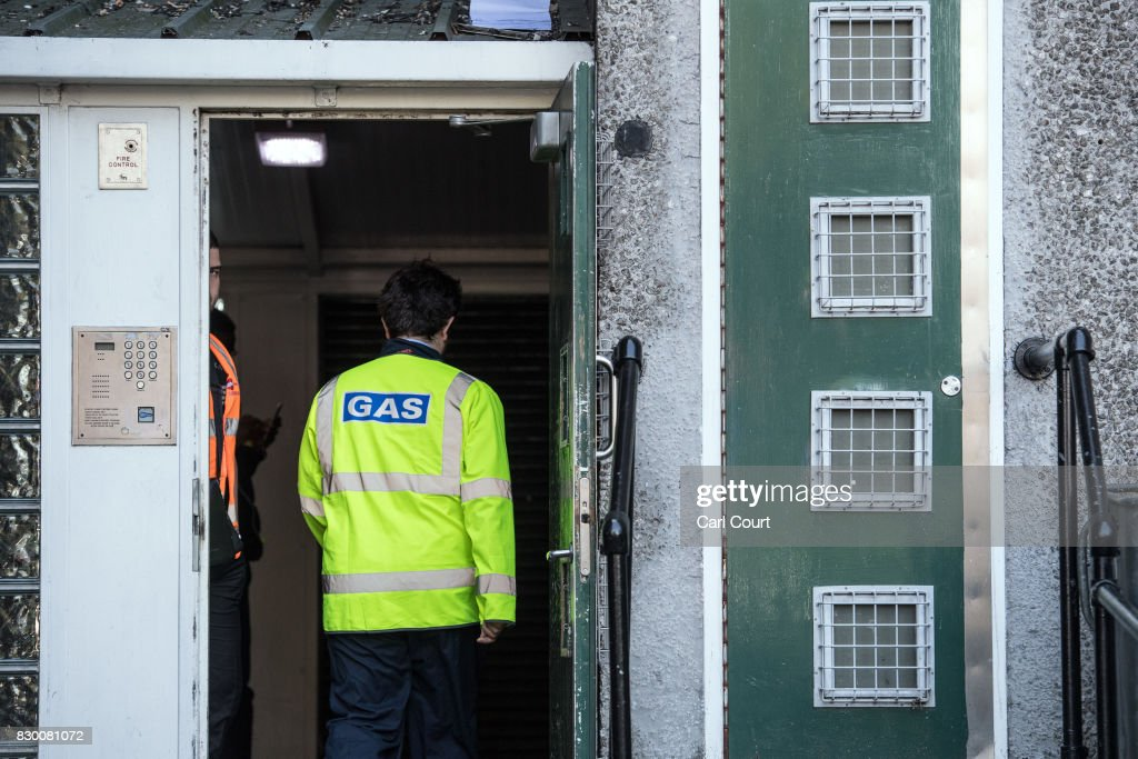 A gas company worker enters a building on the Ledbury Estate on August 11, 2017 in London, England. Hundreds of residents of the estate are to be evacuated from four tower blocks over safety fears after a survey, ordered after the Grenfell Tower fire, found cracks in the walls leaving it vulnerable to collapse in the event of a gas explosion.