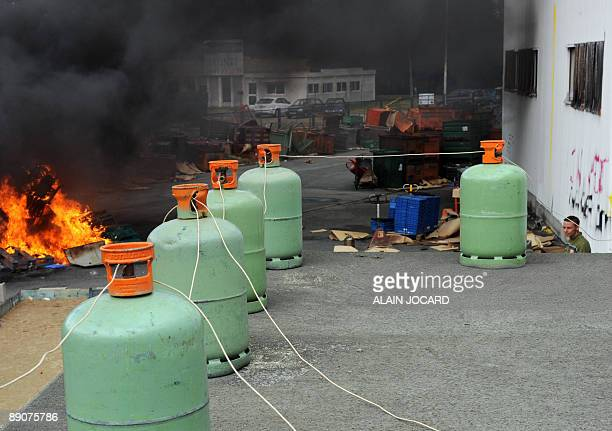 Gas containers are pictured in the New Fabris plant a car parts firm in Chatellerault central France as the fire workers lit on functioning machinery...