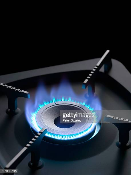 Gas cooker ring with blue flame and copy space