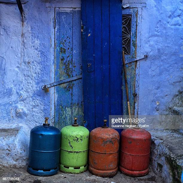 Gas Cylinders Against Old Wooden Door