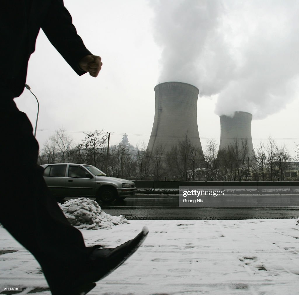 Gas emissions belch from a giant chimney of a power station on February 17, 2005 in Beijing, China. China, the world's second biggest greenhouse gas emitter after the United States and a member of the Kyoto Protocol, which took effect worldwide February 16, has shown its commitment to reducing pollution and switching to renewable energy. However, analysts say it still has a long way to go.