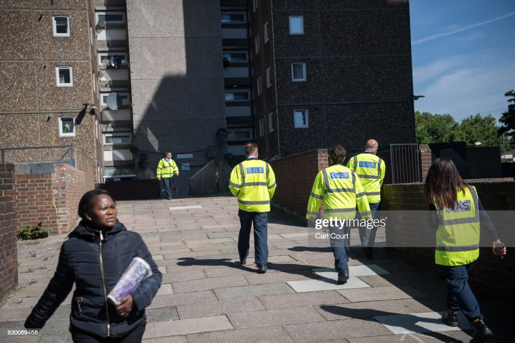 Gas engineers check buildings on the Ledbury Estate on August 11, 2017 in London, England. Hundreds of residents of the estate are to be evacuated from four tower blocks over safety fears after a survey, ordered after the Grenfell Tower fire, found cracks in the walls leaving it vulnerable to collapse in the event of a gas explosion.