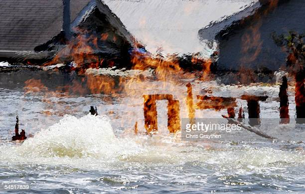 A gas fire burns straight out of the water on Septermber 4 2005 in the Lakeview area of New Orleans Louisiana Most of the people who stayed behind...