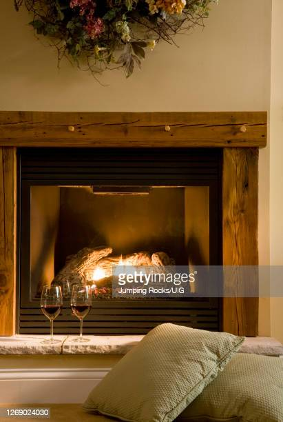 gas fireplace with wine - his and hers stock pictures, royalty-free photos & images