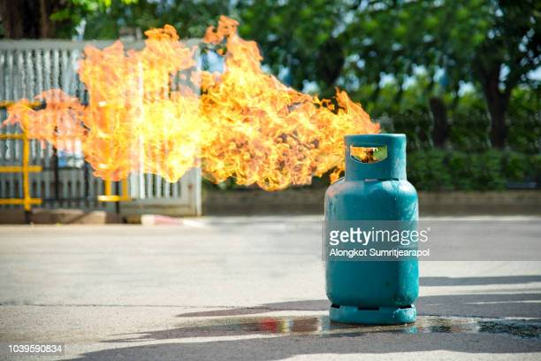 gas flame and explosive from gas tank - cylinder stock pictures, royalty-free photos & images
