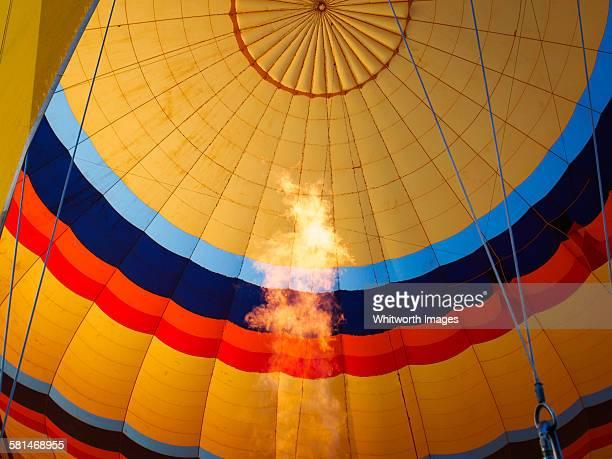 Gas flame inside yellow hot air balloon Turkey