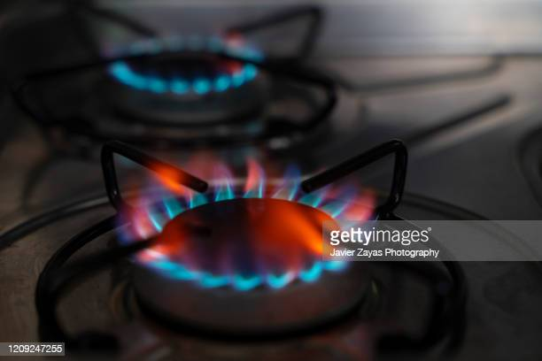 gas flame - gas stock pictures, royalty-free photos & images