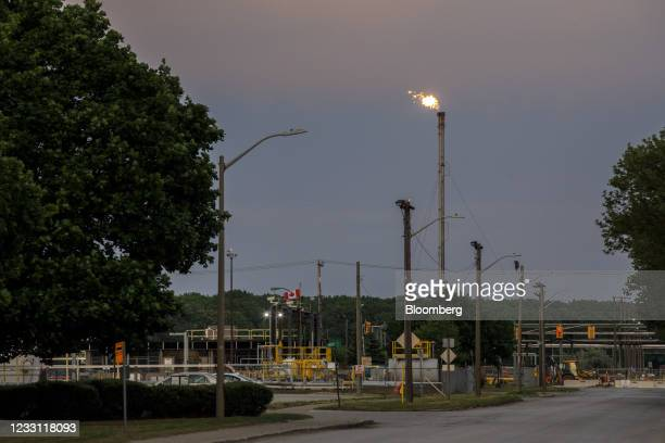 Gas flare burns near the Enbridge Line 5 pipeline in Sarnia, Ontario, Canada, on Tuesday, May 25, 2021. Enbridge Inc. Said it will continue to ship...
