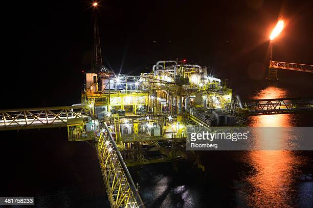 A gas flare burns on a tower right at the Petroleos Mexicanos PolA Platform complex located on the continental shelf in the Gulf of Mexico 70...