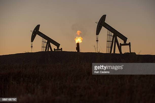 A gas flare is seen burning between two pump jacks near Epping ND on Sept 20 2013 In 2008 the North Dakota oil boom started its ongoing period of...