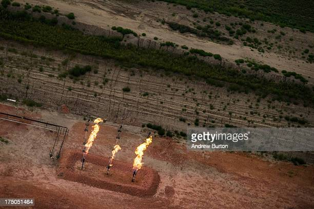 A gas flare is seen in an aerial view in the early morning hours of July 30 2013 near Watford City North Dakota Gas flares are caused when pressure...