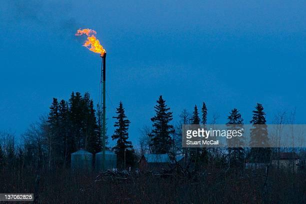 Gas Flare over farm at dusk