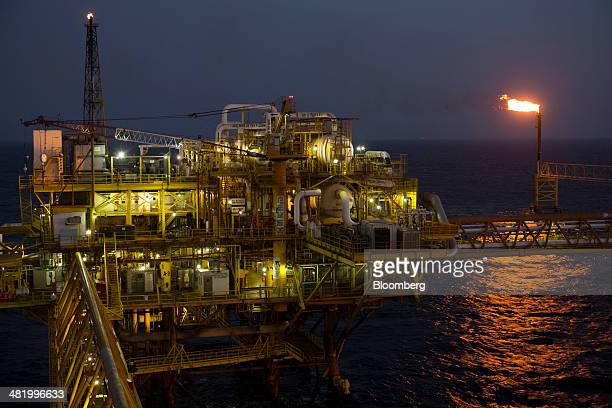 Gas flares at a burner tower right on the Petroleos Mexicanos PolA Platform complex located on the continental shelf in the Gulf of Mexico 70...