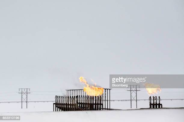 Gas flares stand outside the BP Plc Central Gas Facility in Prudhoe Bay Alaska US on Thursday Feb 16 2017 Four decades after the Trans Alaska...