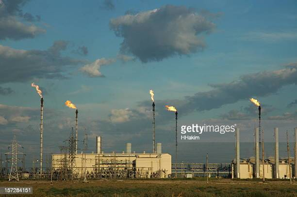 gas flaring - flare stack stock photos and pictures