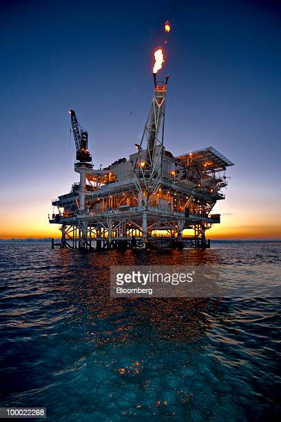Gas is flared off from a flame boom aboard DCOR LLC's Edith offshore oil and gas platform in the Beta Field off the coast of Long Beach California US...