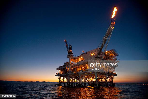 Gas is flared off from a flame boom aboard offshore oil and gas platform Edith in the Beta Field off the coast of Long Beach California US Senators...