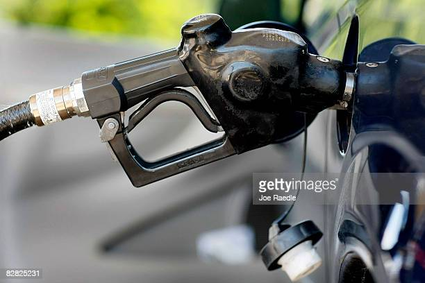 Gas is pumped into a vehicle September 15 2008 in Miami Florida Gasoline prices rose nearly 5 cents a gallon Monday bringing the total increase in...