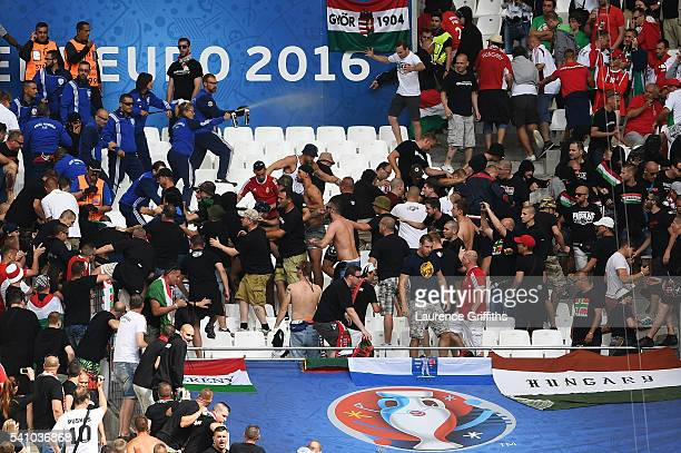 Gas is sprayed to contain Hungary fans prior to the UEFA EURO 2016 Group F match between Iceland and Hungary at Stade Velodrome on June 18 2016 in...