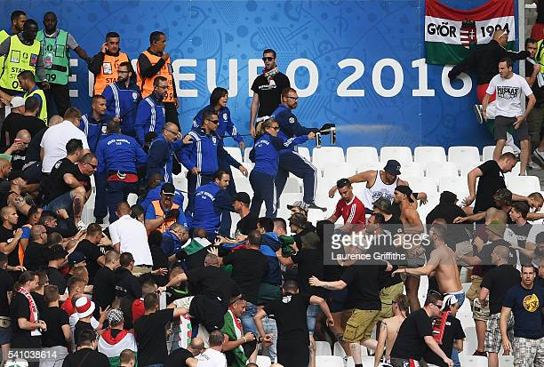 Gas is sprayed to control Hungary fans prior to the UEFA EURO 2016 Group F match between Iceland and Hungary at Stade Velodrome on June 18 2016 in...