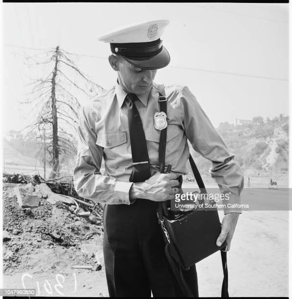 Gas main break Pacific Palisades 7 September 1961 Don Krumsiek William B Nash Gas company employees install control valveCaption slip reads...
