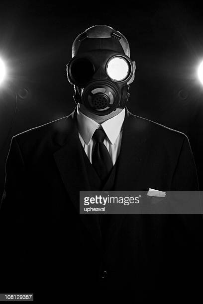 gas mask and neck tie - gas mask stock pictures, royalty-free photos & images
