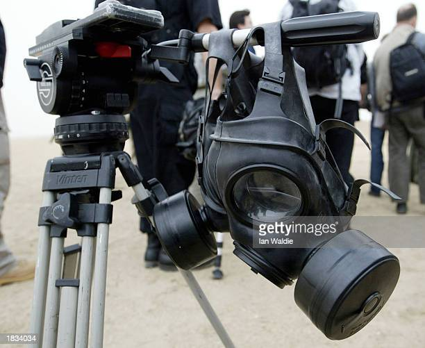 A gas mask is placed on a television tripod at Camp Eagle March 7 2003 near Kuwait City Kuwait British General Sir Michael Jackson Chief of General...