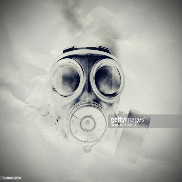 gas mask on paper texture - gas mask stock pictures, royalty-free photos & images