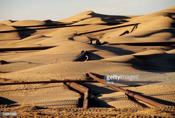 Gas pipeline constructed through sand dunes has been exposed by wind and movement of the desert sands on September, 1997 in Gumdag, Turkmenistan.