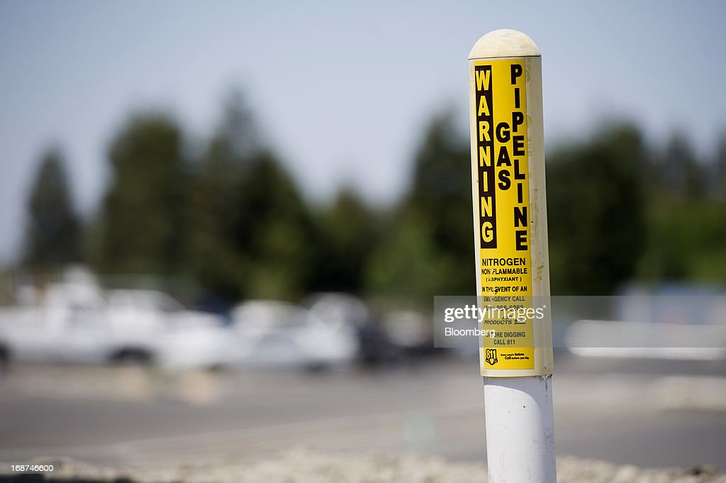 A gas pipeline marker is displayed at the Menlo Equities LLC and Beacon Capital Partners LLC's 460,000 square foot office complex construction site in Santa Clara, California, U.S., on Wednesday, May 1, 2013. Leasing by San Francisco-area technology firms is slowing just as developers are poised to add 6.5 million square feet of office space to the city and Silicon Valley, the most construction in a dozen years. Photographer: David Paul Morris/Bloomberg via Getty Images