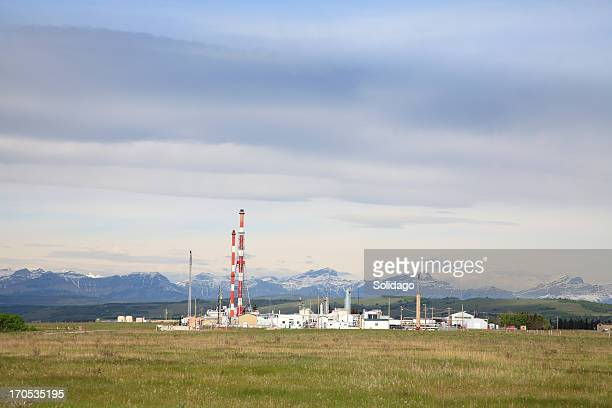 gas plant scenic in foothills - flare stack stock photos and pictures