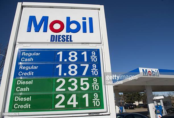 Gas prices are displayed at a Mobil gas station in Woodbridge, Virginia, January 5, 2016. Oil prices fell further January 5 as the crude supply glut...