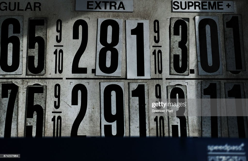 Gas prices are displayed at a station on November 14, 2017 in New York City. According to a new report by the International Energy Agency, (IEA) global oil demand will fall only slightly alongside the predicted rise in electric vehicles over the next two decades. In its World Energy Outlook 2018, the Paris-based group expects oil prices should continue to rise towards $83 a barrel by the mid-2020s and that the U.S. will be a dominant force in global oil and gas markets for many years to come. The IEA report also predicts that the world will use just over 100 million barrels of oil a day by 2025.