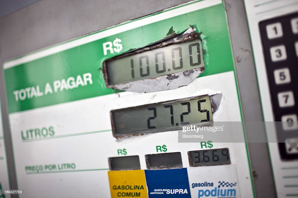 Gas prices are displayed on a pump at a Petroleo Brasileiro SA (Petrobras) station in Rio de Janeiro, Brazil, on Thursday, Jan. 31, 2013. State-controlled oil company Petrobras announced earlier this week that it would raise gasoline and diesel prices by 6.6 percent and 5.4 percent, respectively. Photographer: Dado Galdieri/Bloomberg via Getty Images