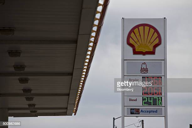 Gas prices are displayed on a sign outside a Royal Dutch Shell Plc fueling station in Chilicothe Illinois US on Friday Dec 11 2015 The cost of a...