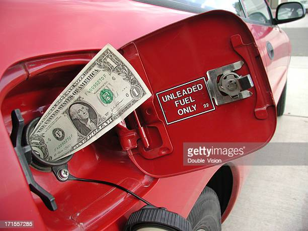 Gas Prices Concept: Dollar Bill Sticking Out of Gas Tank