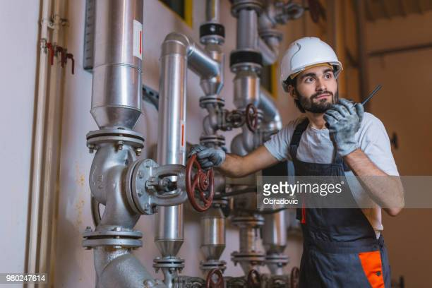 gas production operator - petrochemical plant stock pictures, royalty-free photos & images